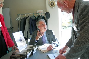 Author signing book for Peter Stanford, President Emeritus, NMHS
